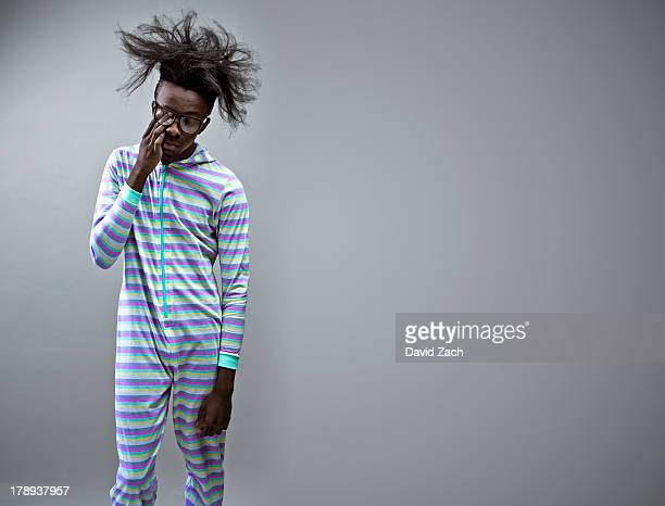 Man wearing onesie, portrait