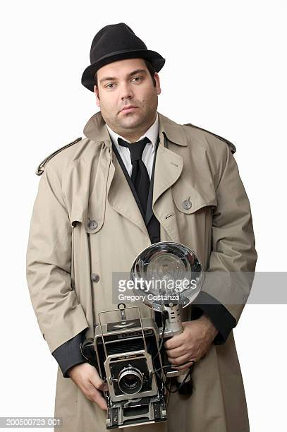 Man wearing press photographer costume