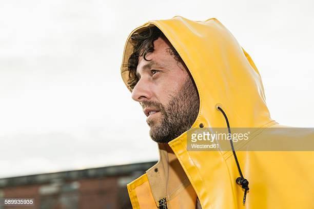 Man wearing rain coat