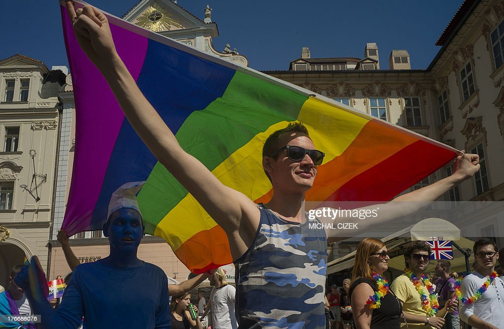 A man wearing rainbow flags takes part in the third gay pride festival in the Czech capital Prague on August 17, 2013.