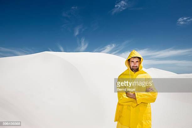 Man Wearing Raincoat in Sun