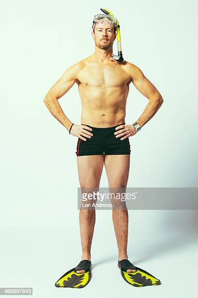 A Man wearing retro bathing suit and snorkle geat