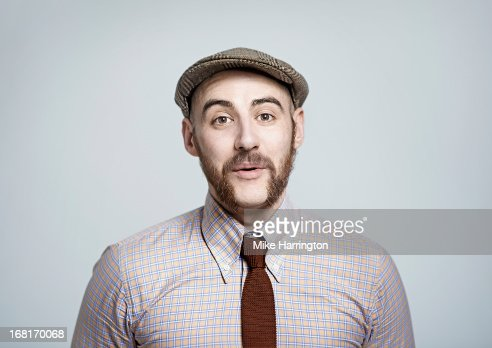 Man wearing retro clothes looking to camera.