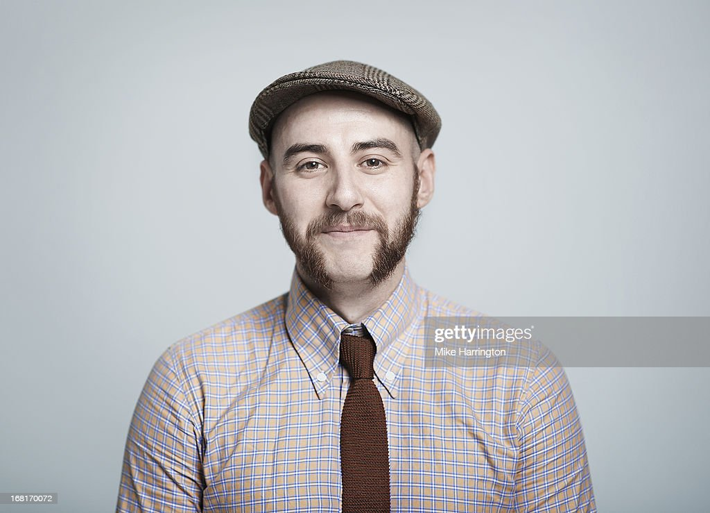 Man wearing retro themed clothes smiling to camera
