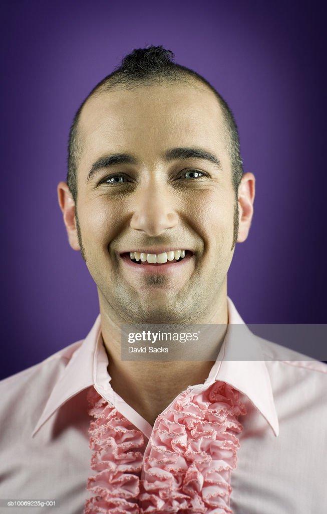 Man wearing ruffled shirt, smiling, portrait, close-up