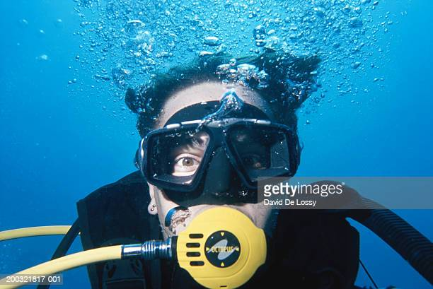 Man wearing scuba mask, underwater view, close-up