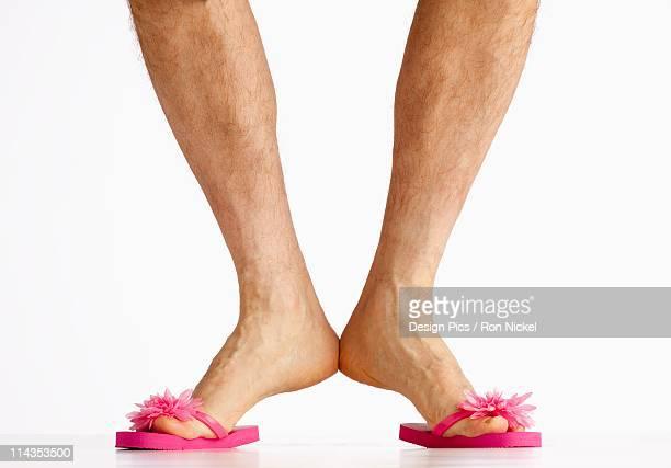 A Man Wearing Small Pink Flip Flops