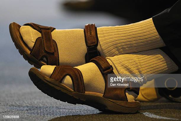 A man wearing socks and sandals listens as Deputy Prime Minister and leader of the Liberal Democrats Nick Clegg speaks during a Question and answer...
