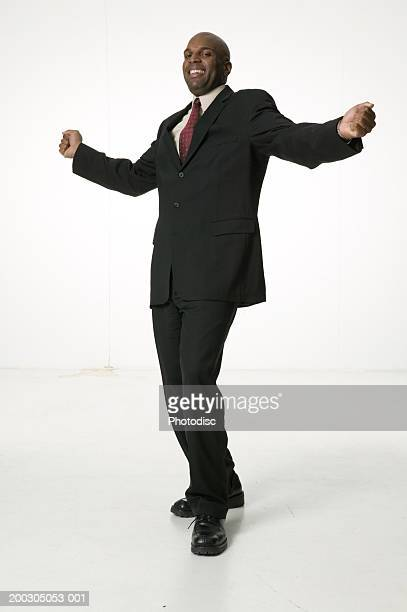 Man wearing suit, dancing