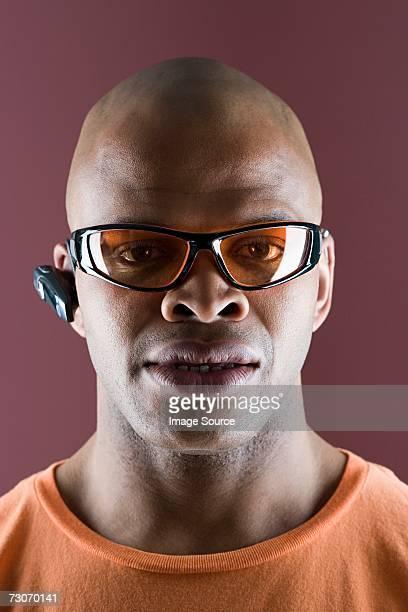 Man wearing sunglasses and headset