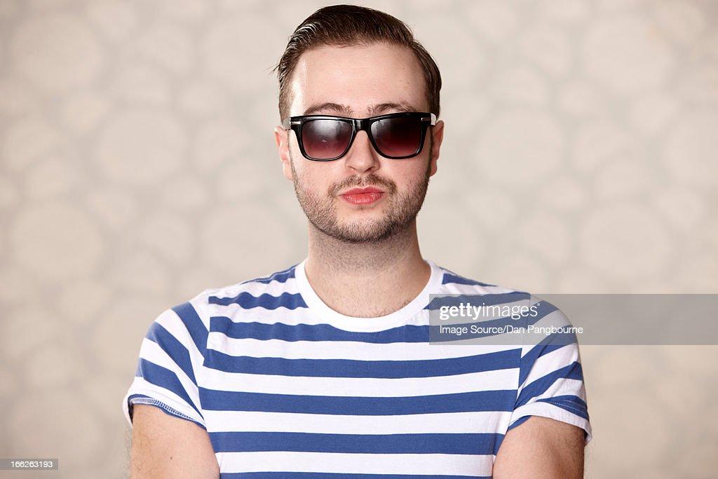 Man wearing sunglasses indoors : Stock Photo