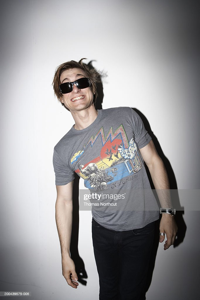 Man wearing sunglasses, smiling, portrait : Stock Photo