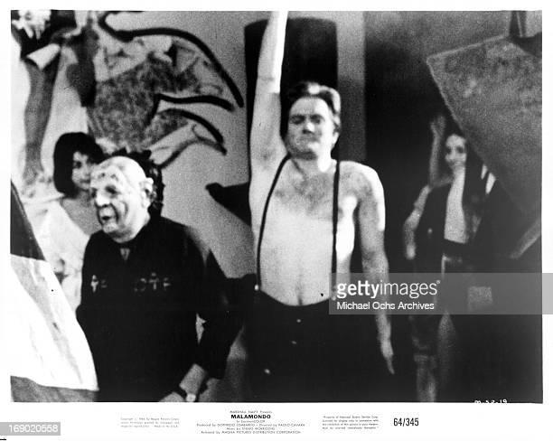 A man wearing suspender on bare skin in a scene from the film 'Malamondo' 1964