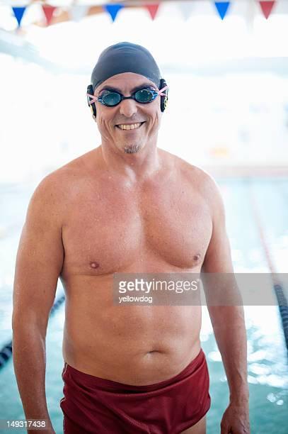 Man wearing swim gear at pool