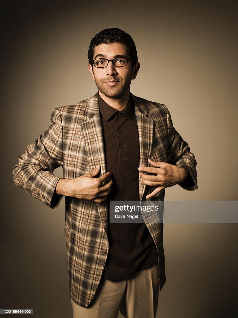 Man wearing tartan jacket, portrait
