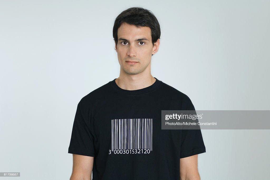 Man wearing tee-shirt with bar code, portrait