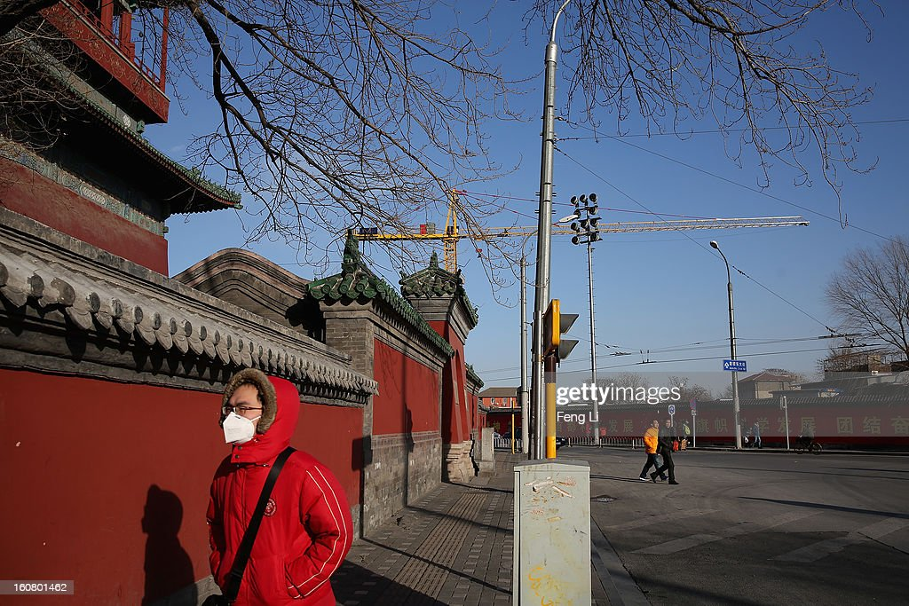 A man wearing the mask passes through the Drum Tower on February 6, 2013 in Beijing, China.