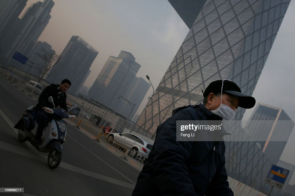 A man wearing the mask walks at the central business district during severe pollution on January 18, 2013 in Beijing, China.