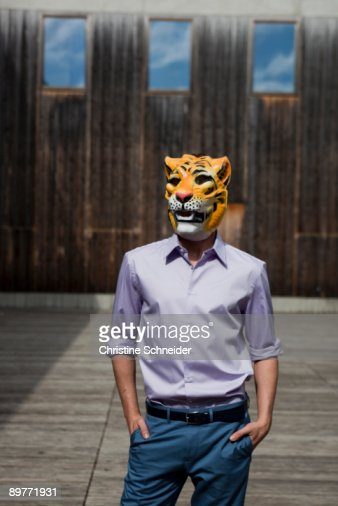man wearing tiger mask outdoor : Stock Photo