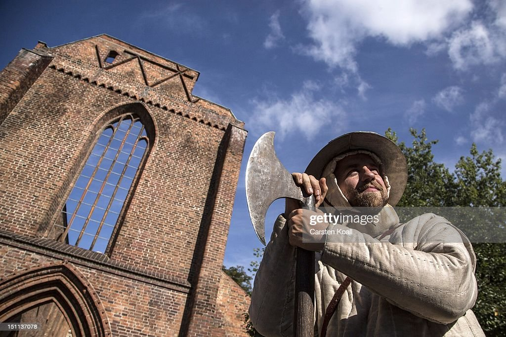 A man wearing traditionally dress poses with a historical weapon stands in front of the ruins of the abbey, once the most important Gothic building in Berlin on September 1, 2012 in Berlin, Germany. The church is part of ongoing exhibitions and events ahead of Berlin's 775th anniversary, which the city will mark with a celebration scheduled for the end of October.