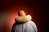 Man wearing travel pillow