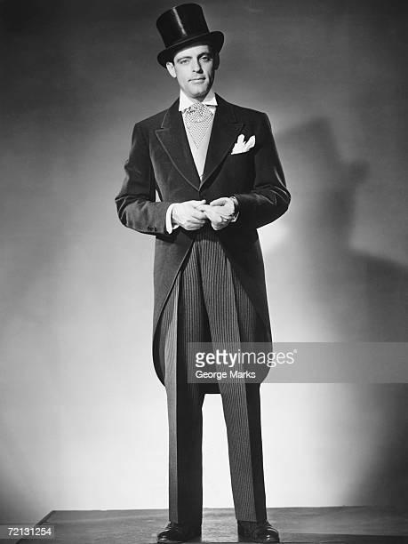 Man wearing tuxedo posing in studio (B&W), portrait