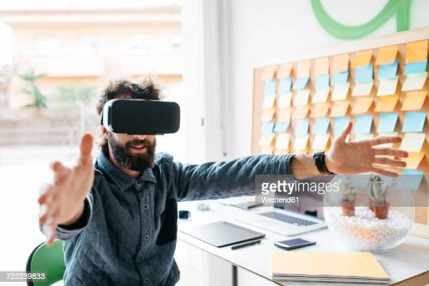Man wearing Virtual Reality Glasses working on new project