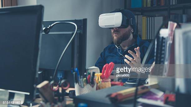 Man wearing virtual reality headset at the office