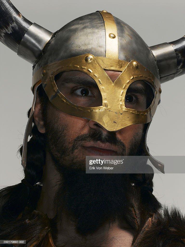 Man wearing warrior helmet, and looking away : Stock Photo