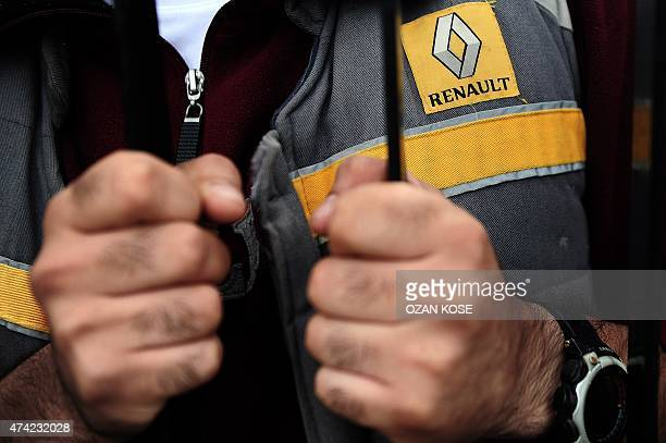 A man wearing working clothes with the Renault logo is pictured inside the factory on May 21 2015 during a strike in Bursa the centre of the Turkish...