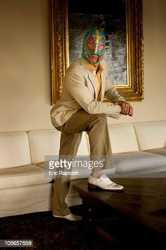 Man wearing wrestling mask in living room