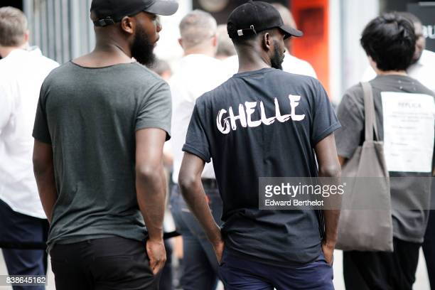 A man wears a cap a black tshirt with the inscription 'ghelle' outside the Y/Project show during Paris Fashion Week Menswear Spring/Summer 2018 on...