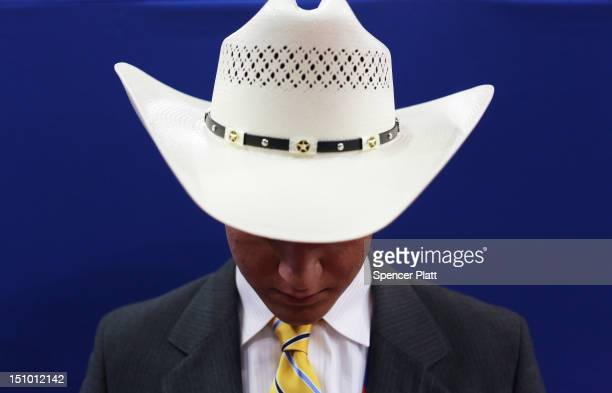 A man wears a cowboy hat during the final day of the Republican National Convention at the Tampa Bay Times Forum on August 30 2012 in Tampa Florida...