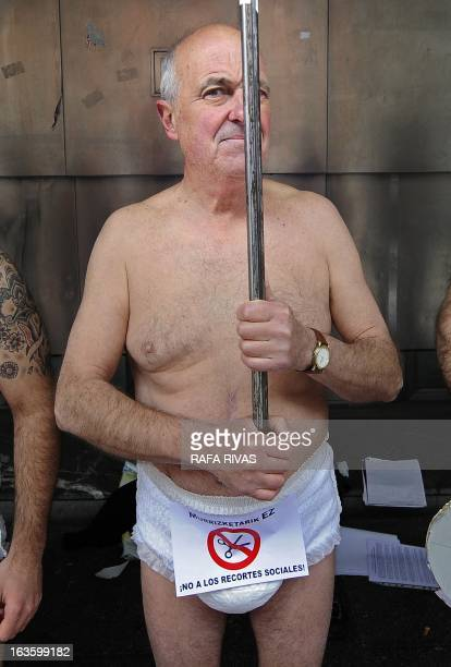 A man wears a diaper during a protest against government's social cuts the construction of a high speed train and the military budget called by the...