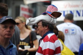 A man wears a donkey head hat at the Carolina Fest street festival during preparations for the Democratic National Convention on September 3 2012 in...
