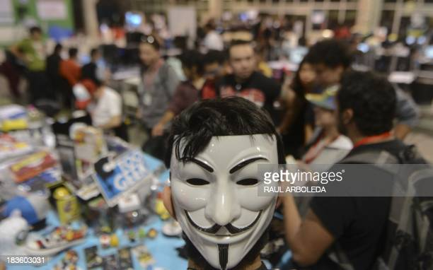 A man wears a Guy Fawkes attends the sixth edition of Colombia's Campus Party on October 7 in Medellin Antioquia department Colombia The Campus Party...