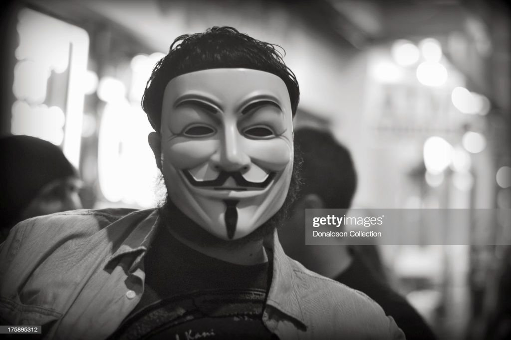 A man wears a <a gi-track='captionPersonalityLinkClicked' href=/galleries/search?phrase=Guy+Fawkes&family=editorial&specificpeople=101029 ng-click='$event.stopPropagation()'>Guy Fawkes</a> mask outside the Viper Room night club on August 2, 2013 in Los Angeles, California .