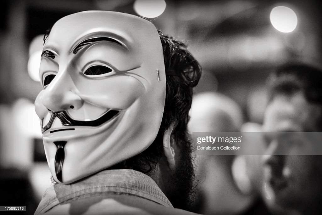 A man wears a Guy Fawkes mask outside the Viper Room night club on August 2, 2013 in Los Angeles, California .