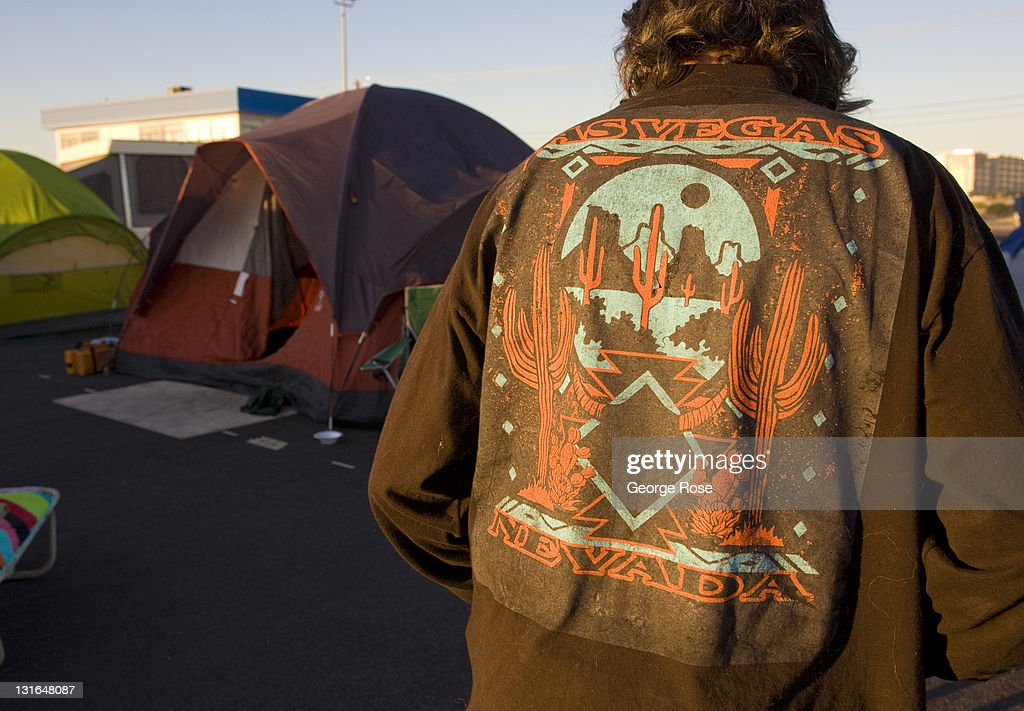 A man wears a Las Vegas shirt outside his tent at the Occupy Las Vegas camp on October 23, 2011 in Las Vegas, Nevada. Located a vacant lot across from the University of Nevada near McCarran International Airport, the turnout by protesters appeared on this day to be low.