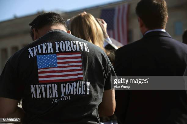 A man wears a 'NEVER FORGIVE NEVER FORGET' tshirt during an observance to commemorate the anniversary of the 9/11 terror attacks at the Pentagon...