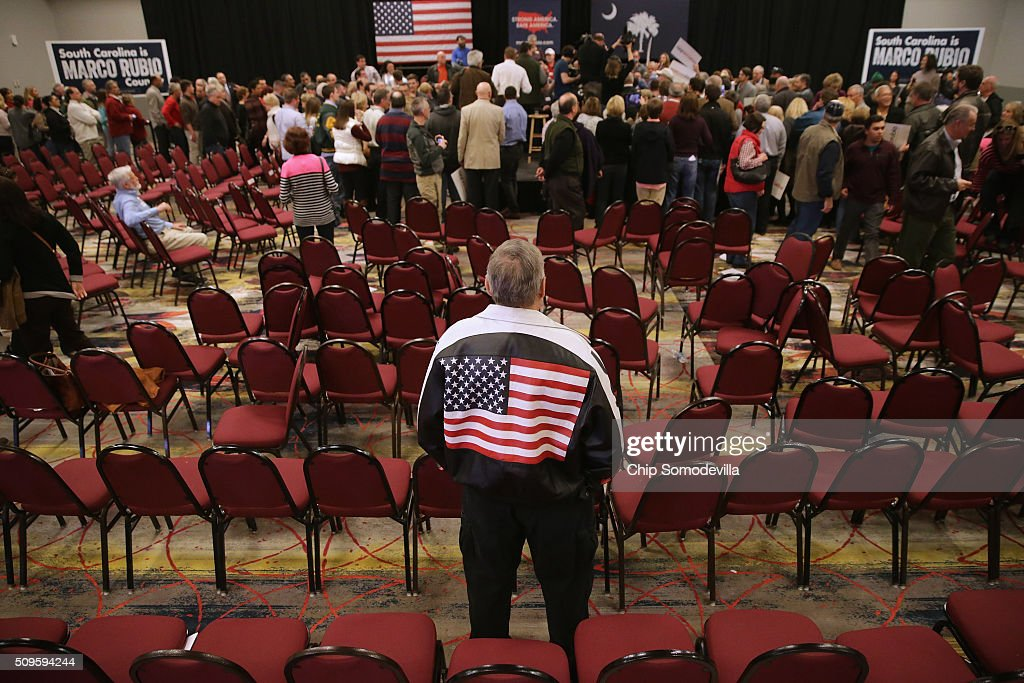 A man wears a patriotic leather jacket to a campaign town hall meeting with Republican presidential candidate Sen. Marco Rubio (R-FL) at the Crown Reef Beach Resort February 11, 2016 in Myrtle Beach, South Carolina. Earlier in the week Rubio placed fifth in the New Hampshire primary, behind fellow GOP candidates Jeb Bush, John Kasich, Sen. Ted Cruz (R-TX) and Donald Trump, who won with 35 percent of the vote.