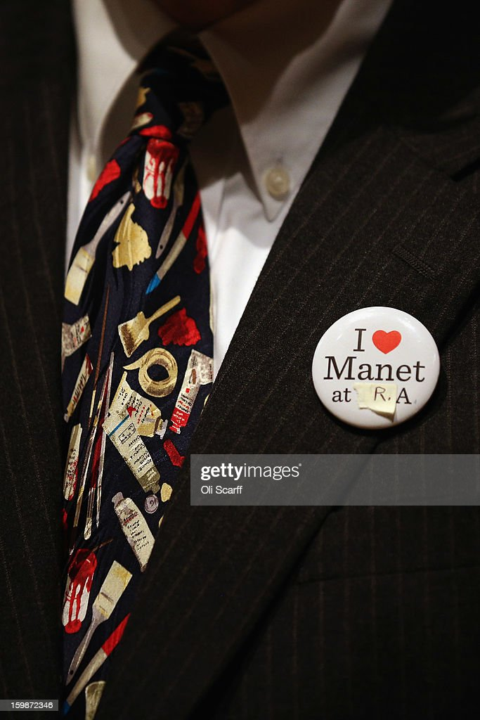 A man wears a pin badge supporting the exhibition of paintings by Edouard Manet in the Royal Academy of Arts on January 22, 2013 in London, England. The painting features in the Royal Academy's new exhibition 'Manet: Portraying Life' which displays over 50 paintings spanning his career. The exhibition open to the general public on January 26, 2013 and runs until April 14, 2013.