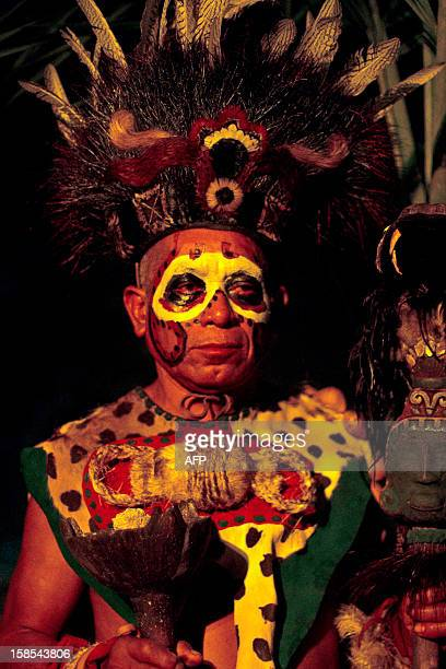A man wears a preHispanic Mayan costume in a recreation at Xcaret Park in Playa del Carmen in Quintana Roo state Mexico on December 18 during...