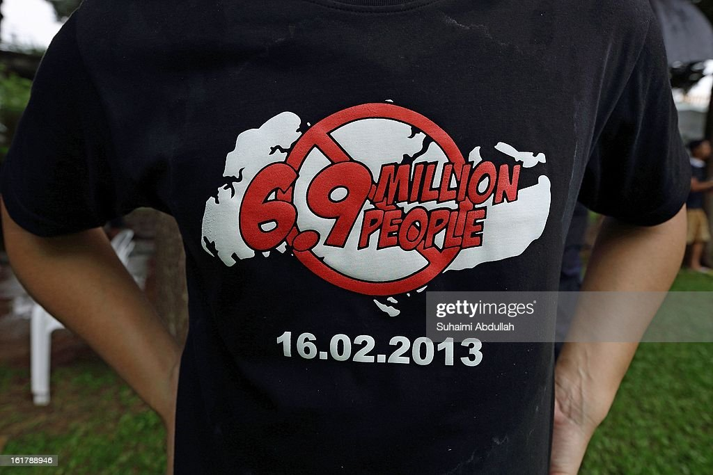 A man wears a protest t-shirt during the protest against the government's White Paper on Population in Hong Lim Park at Speakers' Corner on February 16, 2013 in Singapore. Thousands of protesters gathered today following the release of a government white paper on population that revealed it could increase 30% to 6.9 million by 2030, angering residents who already see a strain on housing, transportation and healthcare.