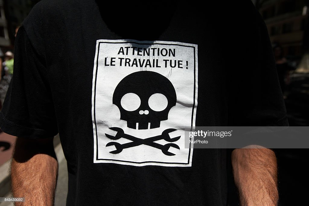 A man wears a shirt redaing 'Beware, Work kills !' during a protest against the El-Khomri bill on labour reforms in which more than 6000 people took part. They also protest against the use of article 49.3 which bypass the Parliament . Toulouse. France. June 28th, 2016.