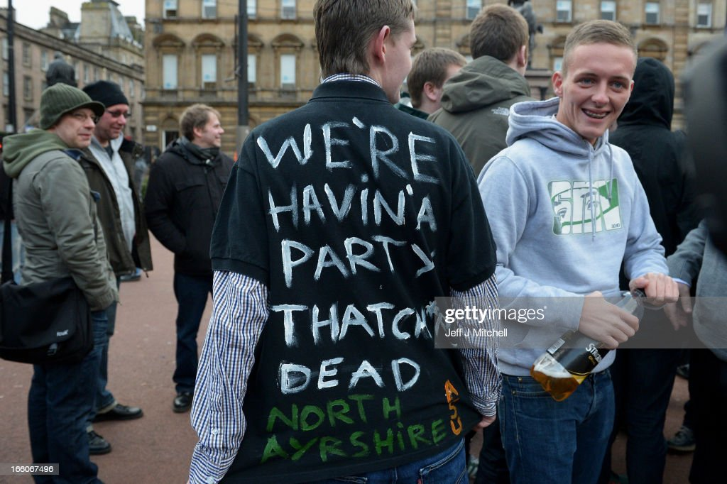 A man wears a t-shirt displaying a celebratory message as other members of the public gather in George Square to mark the death of Baroness Margaret Thatcher on April 8, 2013 in Glasgow, Scotland. It has been confirmed that Lady Thatcher has died this morning following a stroke aged 87. Margaret Thatcher was the first female British Prime Minster and governed the UK from 1979 to 1990. She led the UK through some turbulent years and contentious issues including the Falklands War, the miners' strike and the Poll Tax riots.