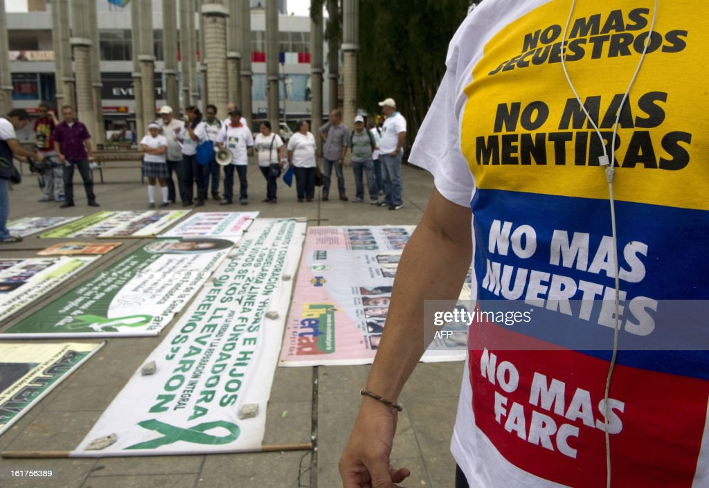 A man wears a t-shirt reading 'No more kidnappingss, no more lies, no more deaths, no more FARC' as he takes part in a march to protest against the Revolutionary Armed Forces of Colombia (FARC) guerrillas and to ask for the release of hostages on February 15, 2013 in Medellin, Antioquia department, Colombia. AFP PHOTO/Raul ARBOLEDA