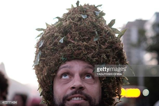 A man wears a wig mocking marijuana during a march calling for the legalization of marijuana at Ipanema Beach in Rio de Janeiro Brazil on May 9 2015...