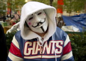 A man wears an Anonymous mask and a NY Giants jacket at the Occupy Wall Street encampment November 5 2011 in New York AFP PHOTO/DON EMMERT