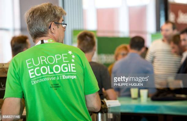 A man wears an Europe Ecologie Les Verts green party Tshirt during EELV summer congress on August 24 2017 in Dunkerque northern France / AFP PHOTO /...